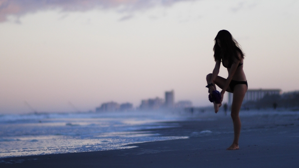 a girl modeling at the beach