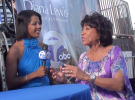 Diana Lewis and her daughter doing a retirement newscast at The Woodward Dream Cruise