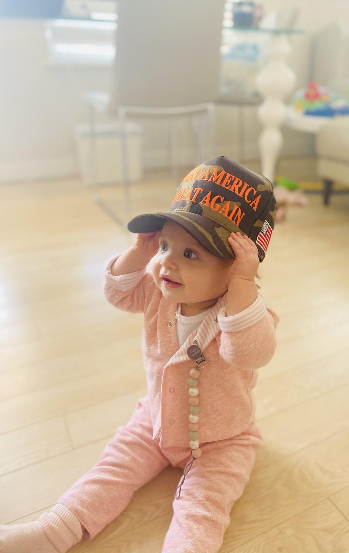 Kayleigh McEnany's baby wearing a Maga cap