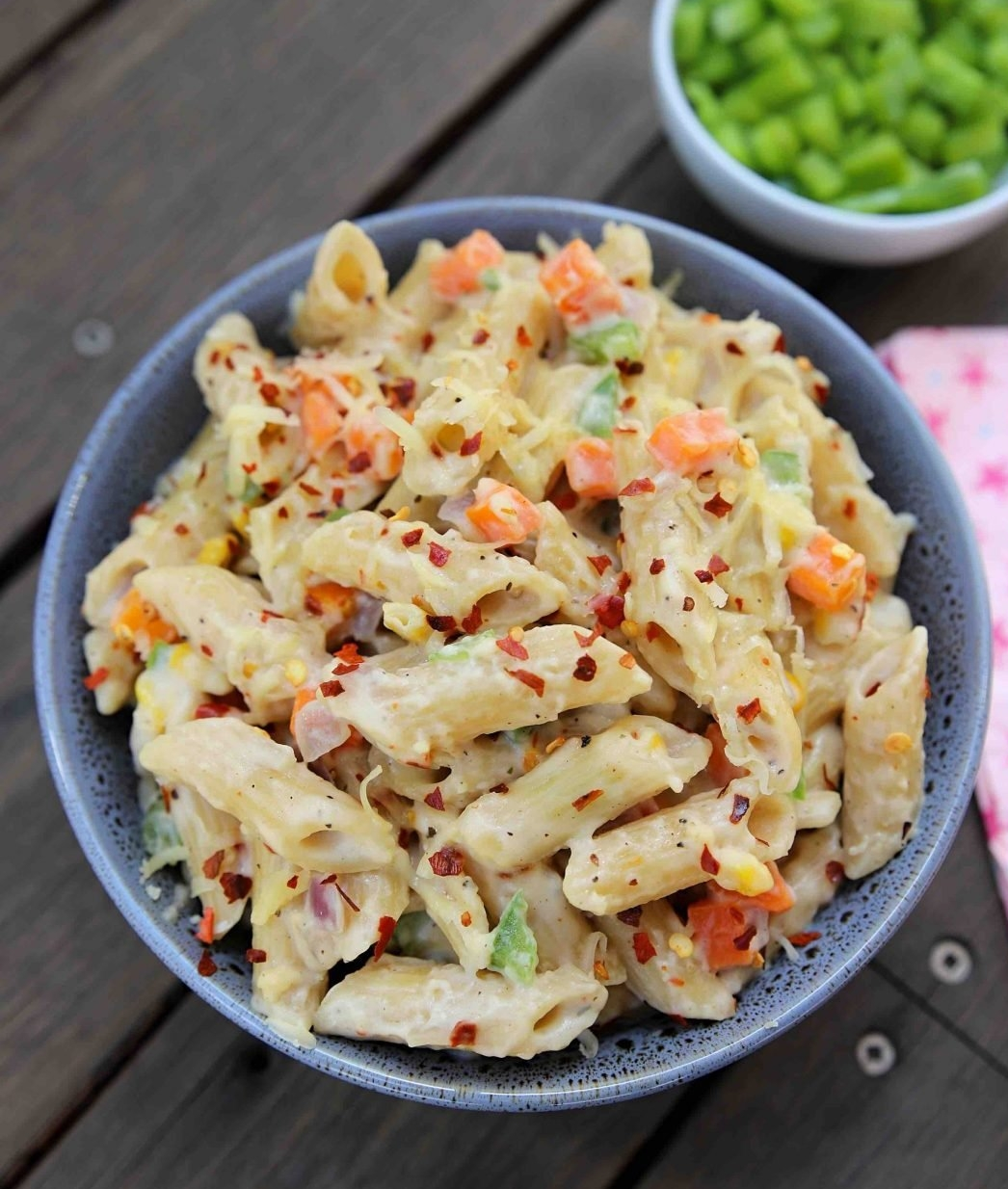 mayo pasta with chopped vegetables and herbs