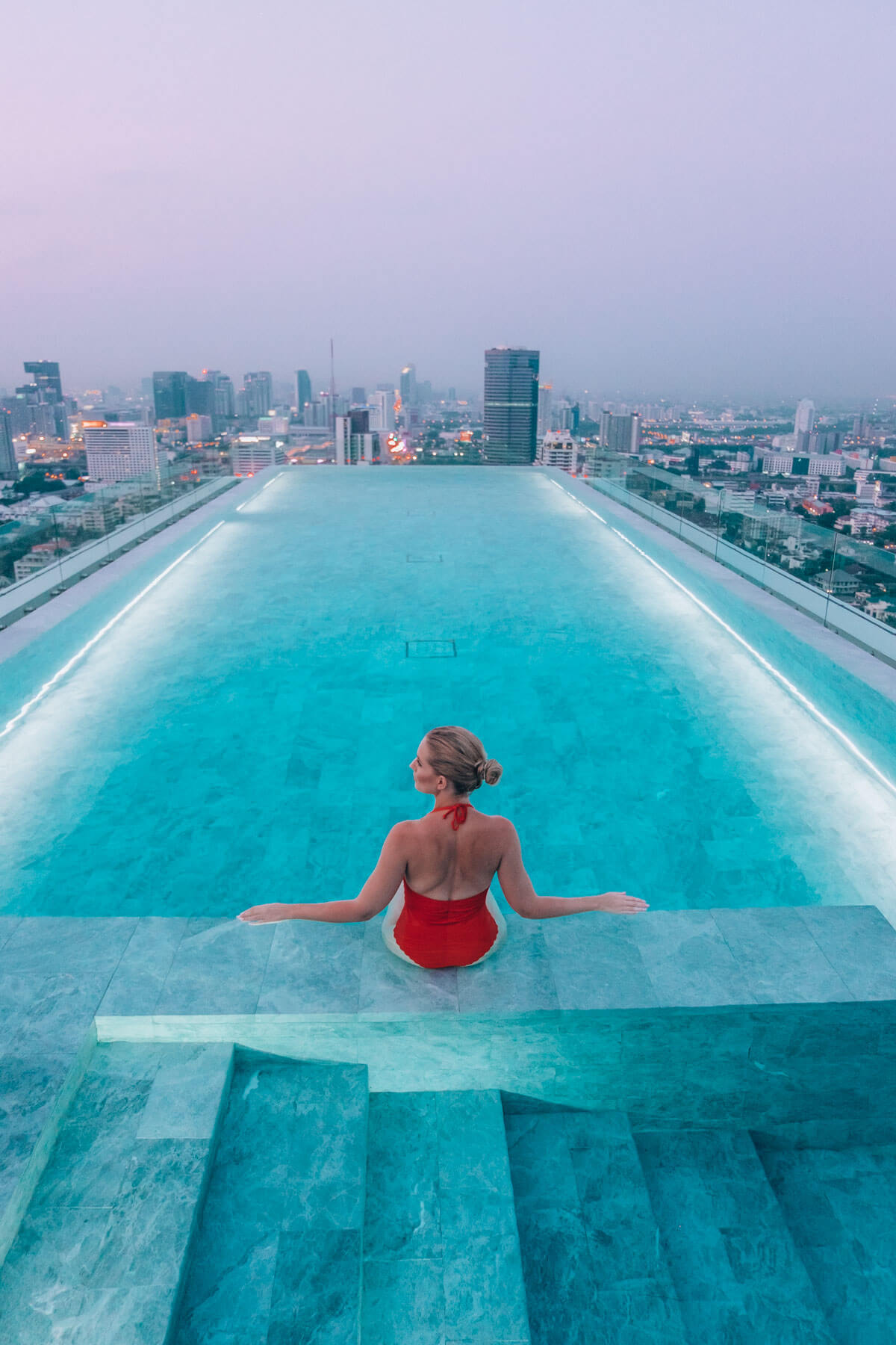 Ajda Sitar in a swimming pool on the roof of 137 Pillars in Bangkok