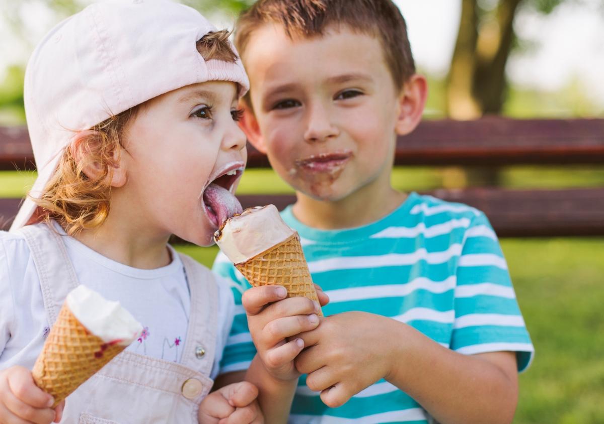 a kid licking ice cream