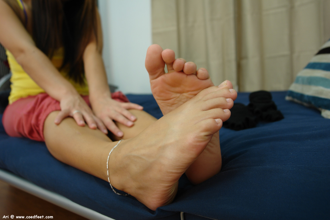 a college girl named Ari showing her feet