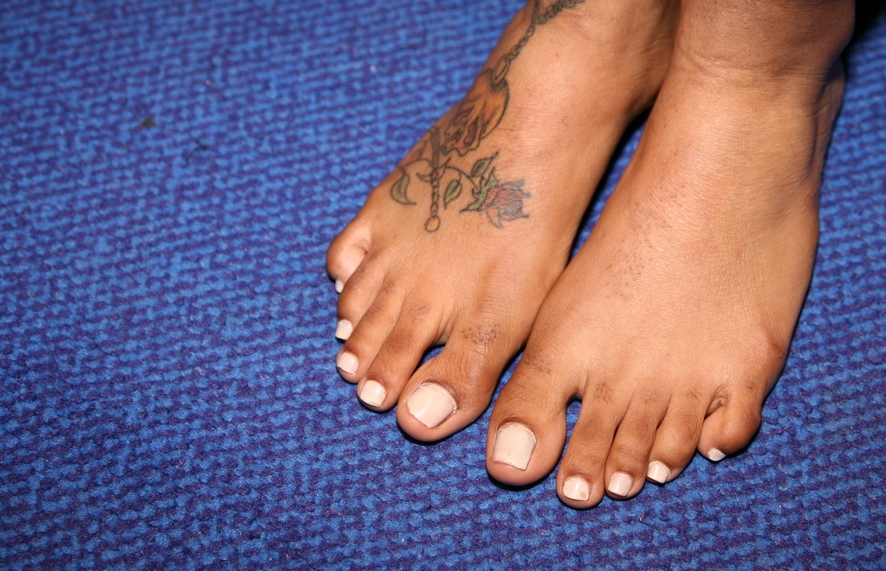 a Jamaican girl showing her feet