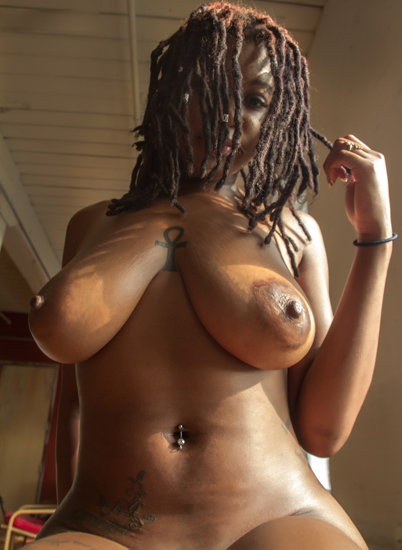 a girl showing her tits