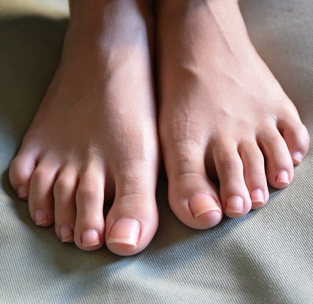 a girl named Neha showing her toes
