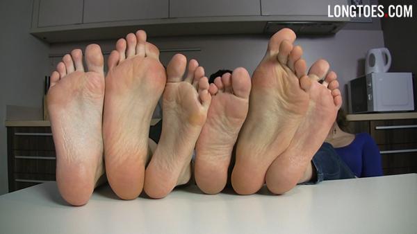 three girls showing their feet
