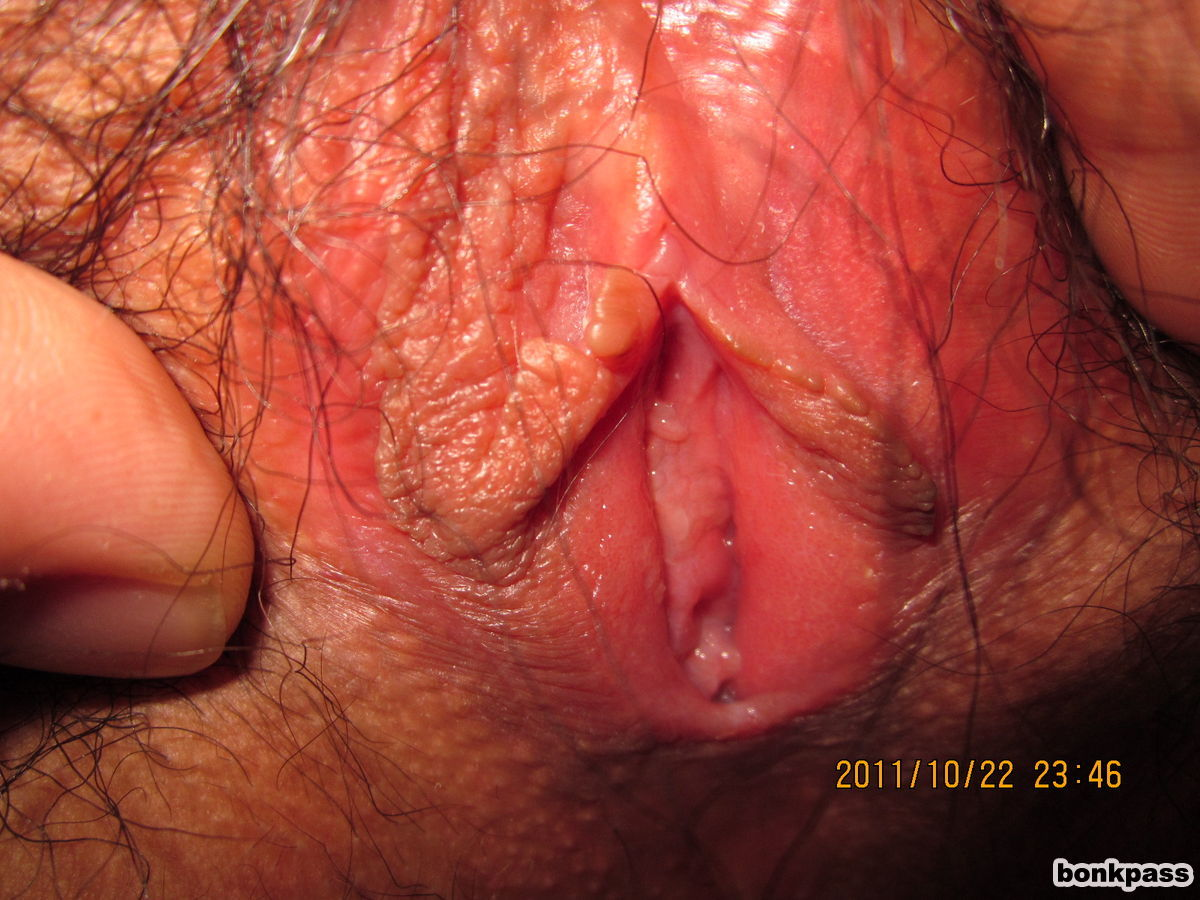 a girl showing her hairy pussy