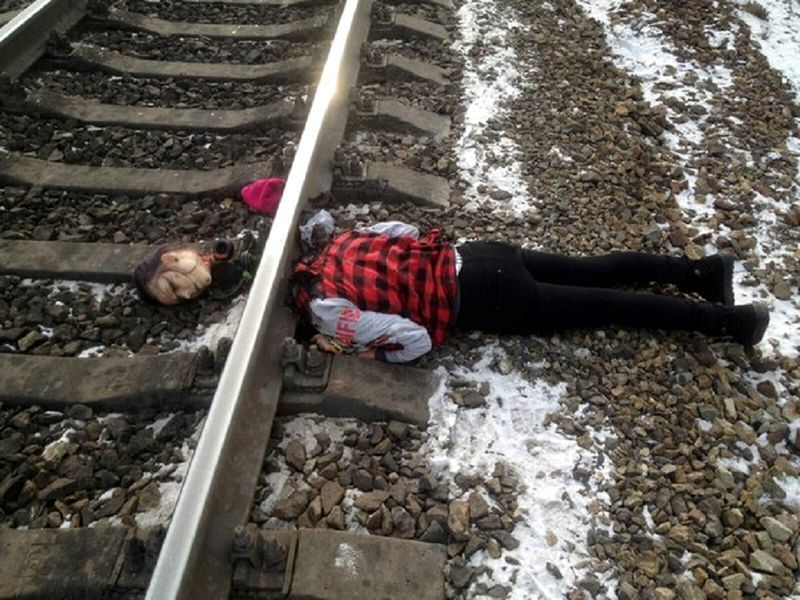 a girl lying dead after being decapitated by a train