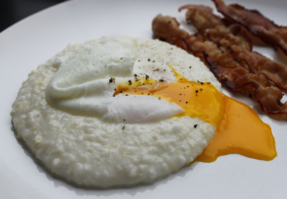 grits with a poached egg and bacon