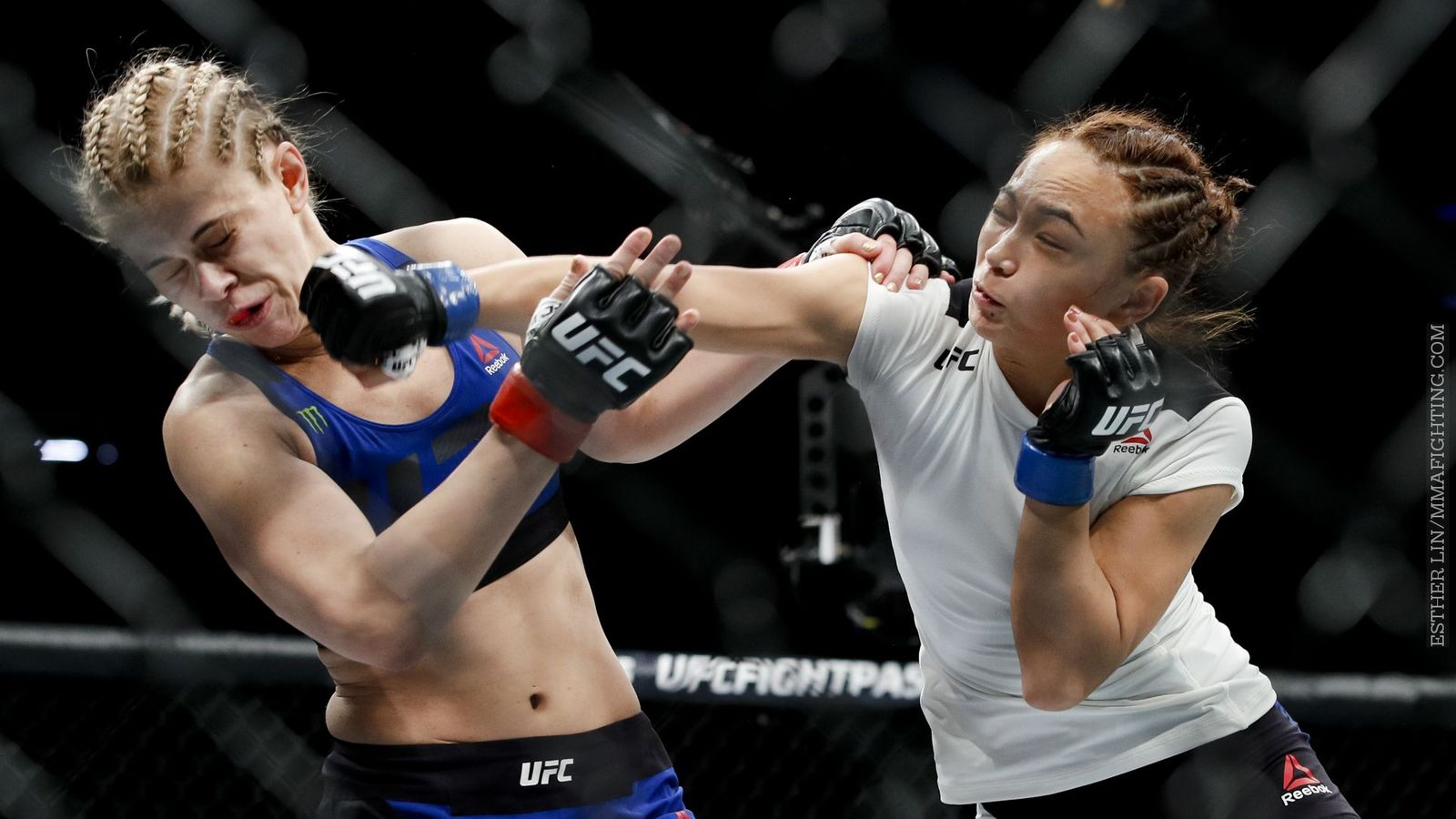 Michelle Waterson punching Paige VanZant in the face during their match at UFC On Fox