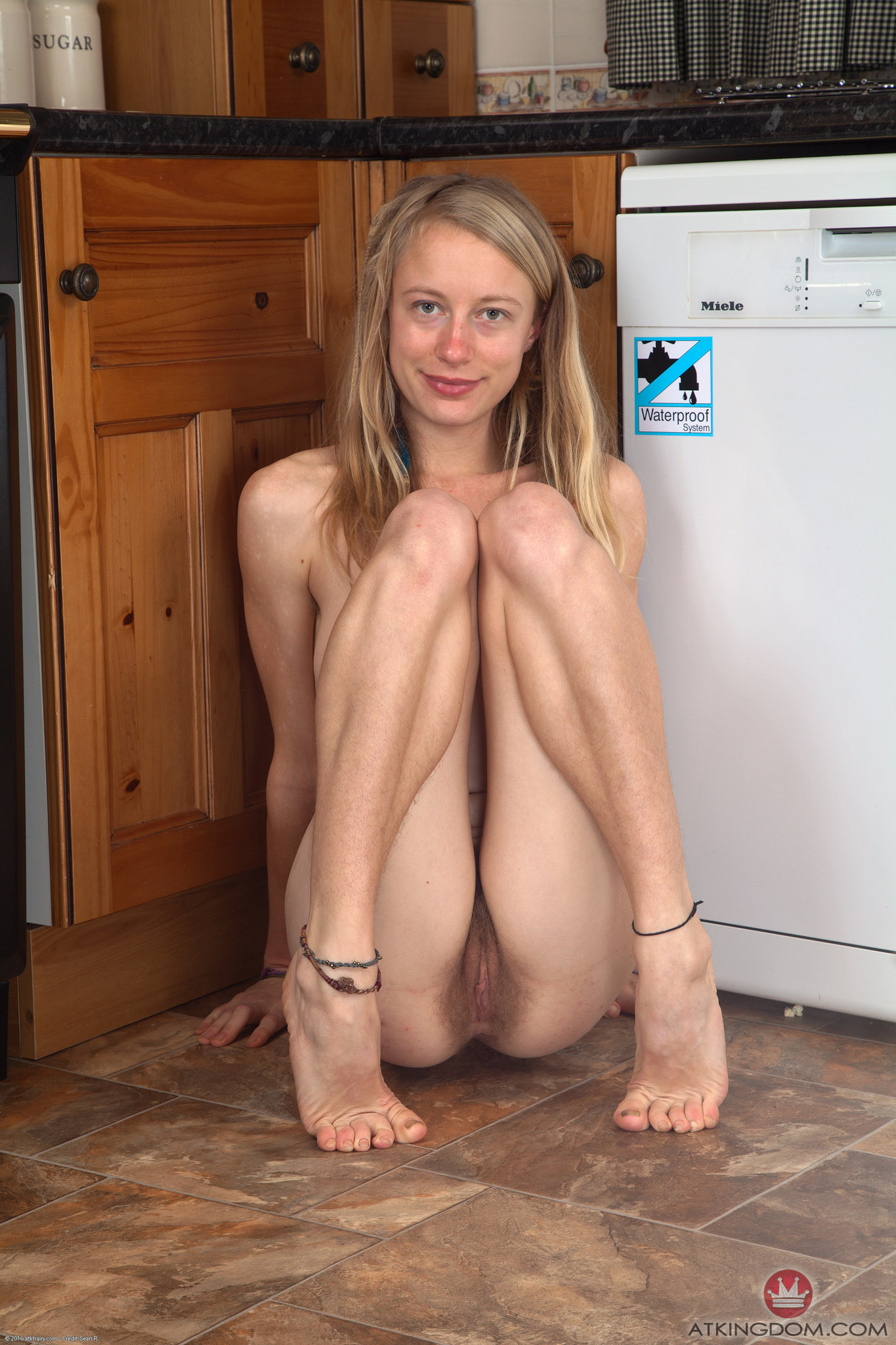 a woman named Selena spreading her pussy and posing nude