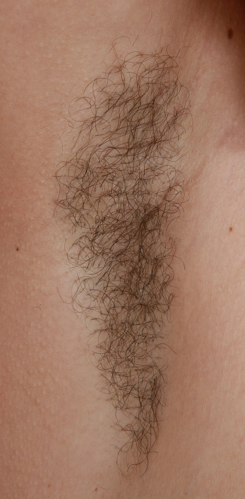 a woman named Rita showing her armpit hair title=