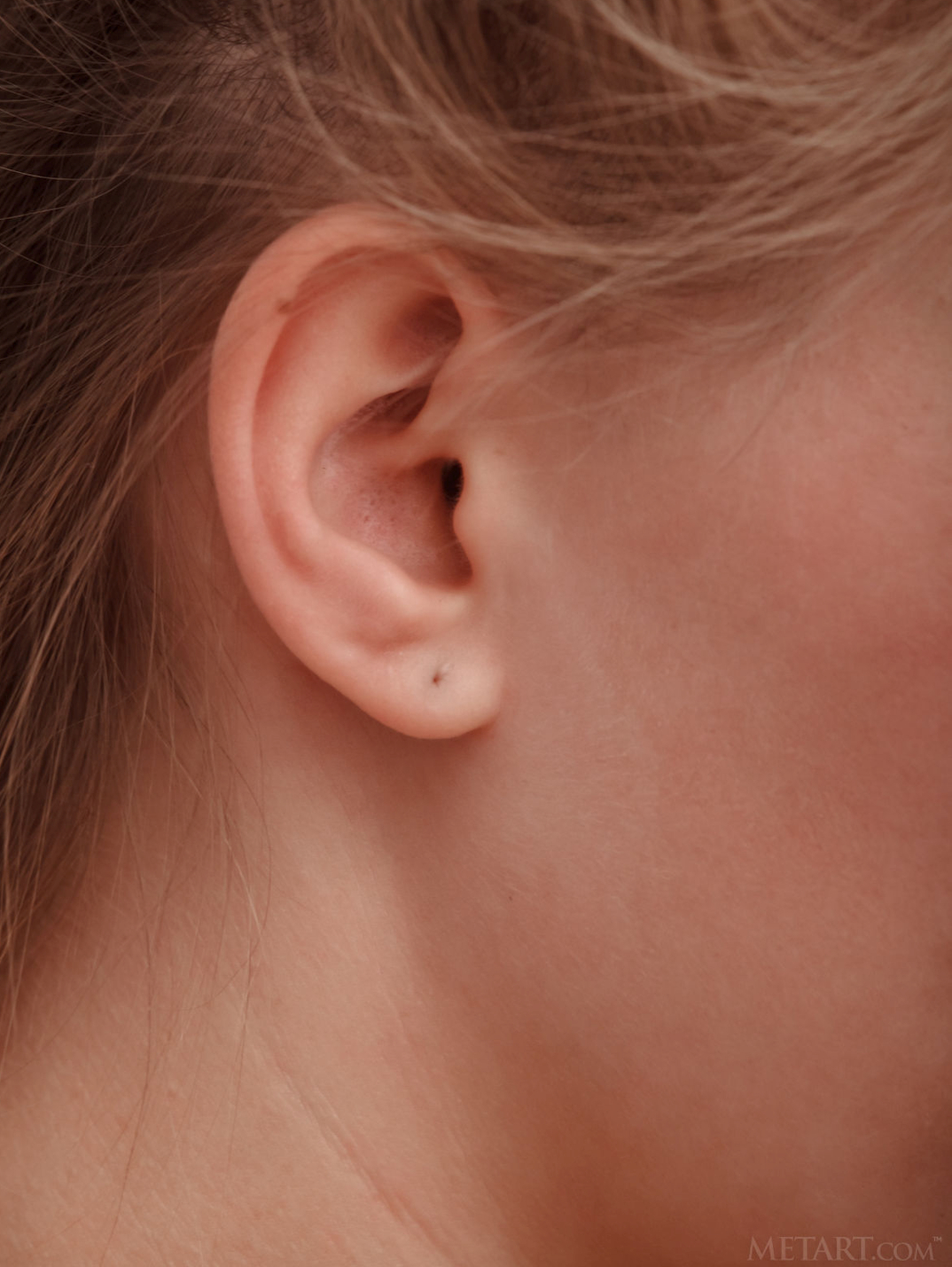 a girl named Adagio showing her ear