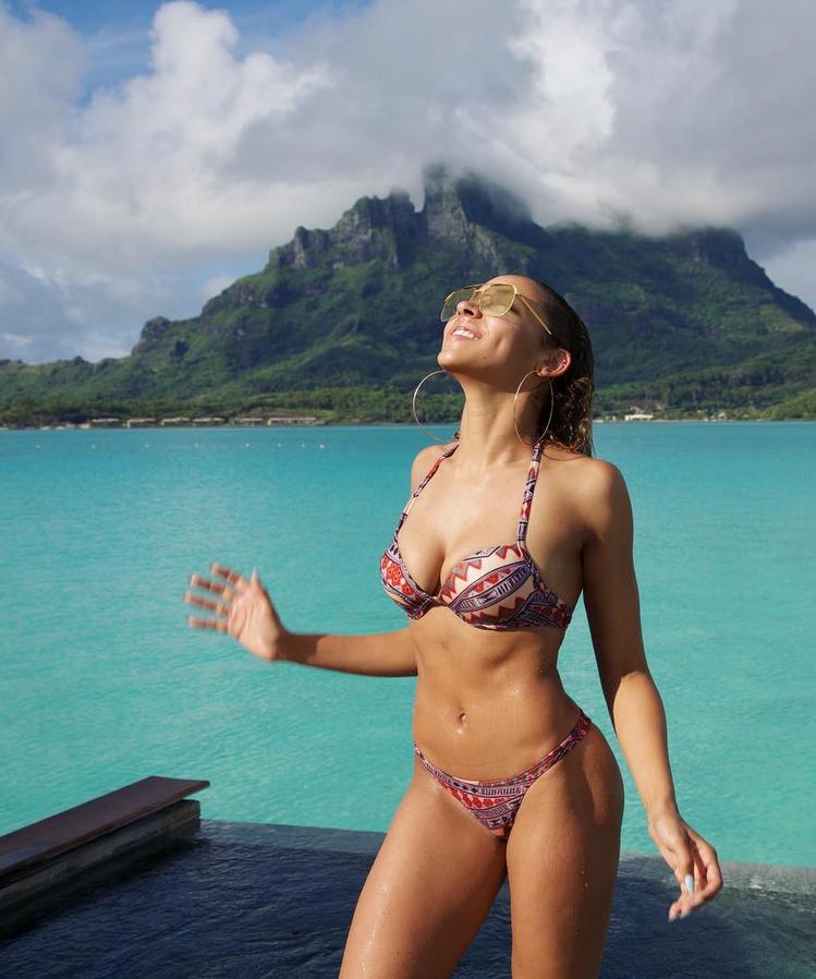Tinashe posing in a bikini