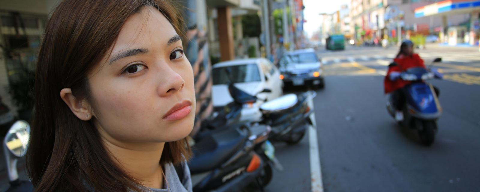 a girl posing near a street