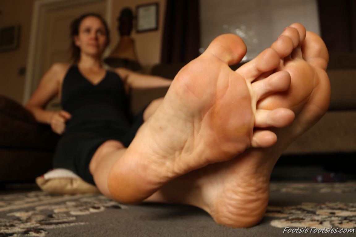 a woman named Celeste showing her feet