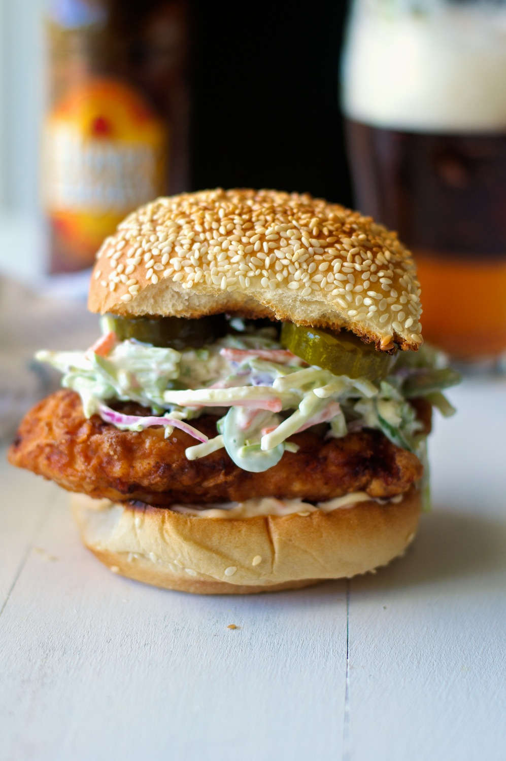 a fried chicken sandwich with jalapeño broccoli slaw