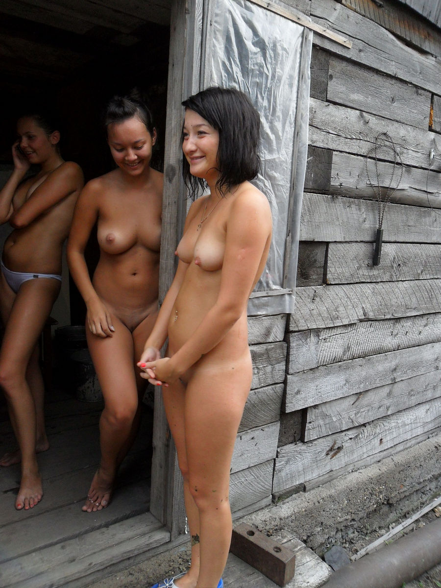 a girl posing nude with friends