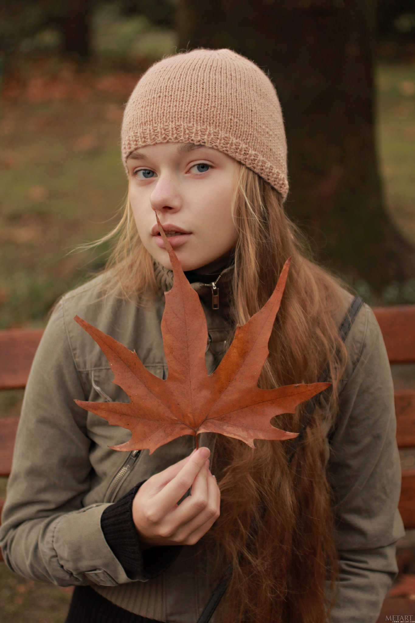 a Ukrainian girl named Milena posing with a leaf