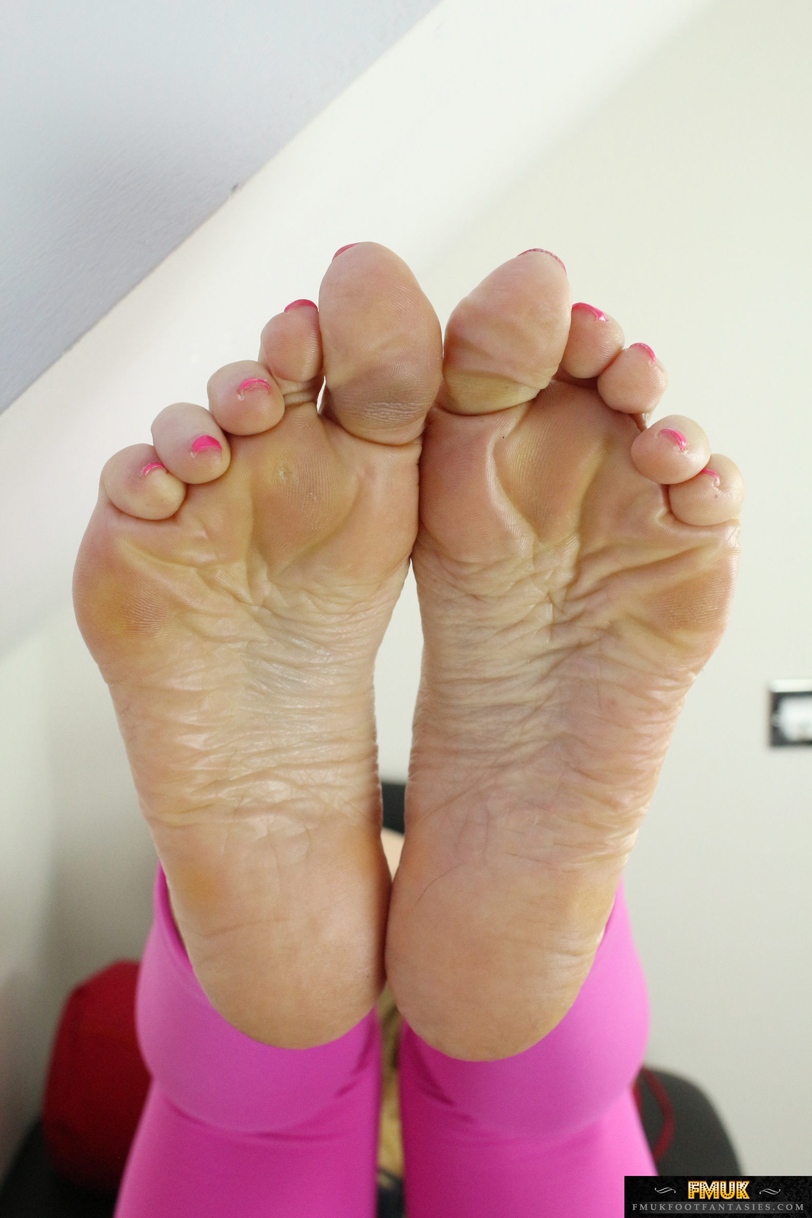 a woman named Louise showing her feet
